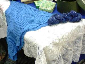 Knitted shawl, Torchon tablecloth & box, hand-spun wool